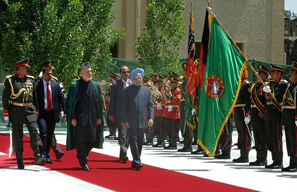 File photo of Dr Singh inspecting a guard of honour with Afghan President Hamid Karzai in Kabul