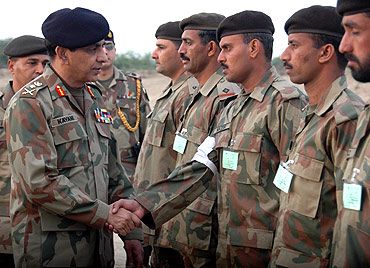 Pakistan's Army chief General Ashfaq Kayani meets soldiers during the test-firing of a medium-range Shaheen-1 ballistic missile at an undisclosed location in Pakistan