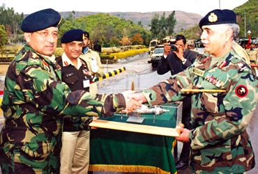 A file photograph of former Pakistani president Pervez Musharraf with Lieutenent General Ghulam Mustafa, then commander of Pakistan's Army Strategic Force, during a ceremony to hand over Hatf-111 Ghaznavi missiles at an undisclosed location