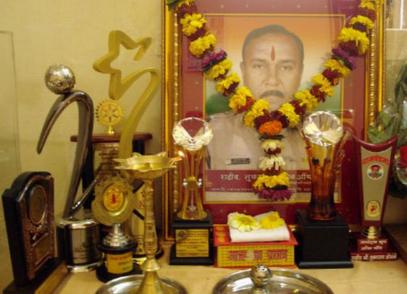 A framed photograph of sub-inspector Tukaram Omble along with several awards received for his bravery at his home in Worli