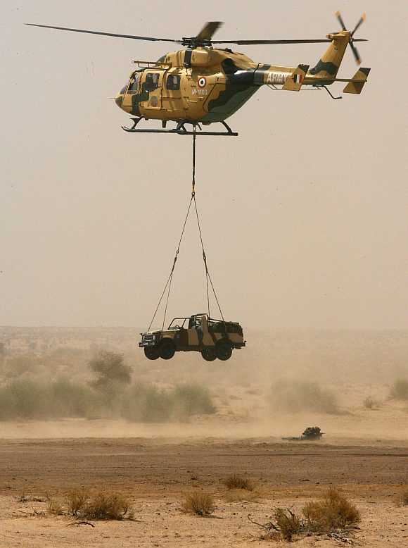 An Indian army jeep is lowered by a helicopter at the Pokharan firing range