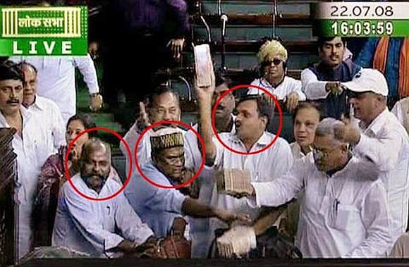 TV grab of BJP MPs flashing bundles of currency notes in Parliament during the trust vote in 2008.