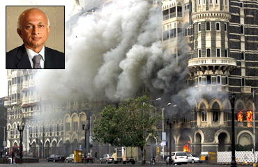 The Taj Mahal hotel is seen engulfed in smoke during a gun battle in Mumbai. Inset: Foreign Secretary Ranjan Mathai