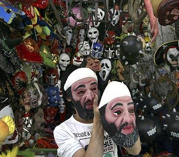 A vendor sells masks of Al Qaeda founder Osama bin Laden