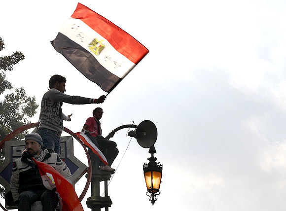An Egyptian protester waves a flag
