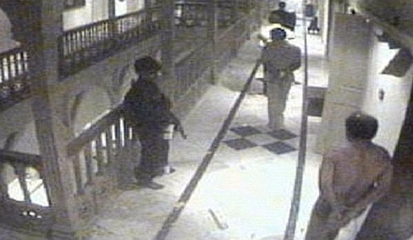 A grab taken from the Taj Hotel CCTV footage shows a terrorist shifting hostages to another room