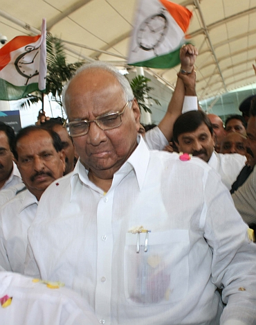 NCP chief Sharad Pawar arrives at Mumbai airport on Friday
