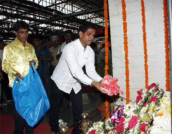 Commuters pay their respects at the CST memorial