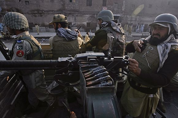 Paramilitary forces patrol the streets of Peshawar, in northwest Pakistan on Saturday after a NATO airstrike