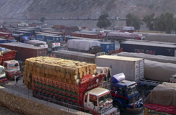 Cargo trucks, including those carrying supplies to NATO forces in Afghanistan, are seen halted along the Pakistan-Torkham border