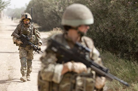 British army soldiers patrol outside Patrol Base Chilli near Lashkar Gah in Helmand province in Afghanistan