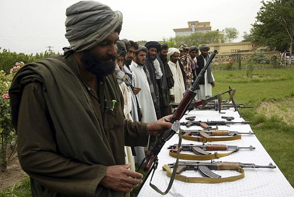Members of the Taliban voluntarily handed over their weapons and joined the government in Herat