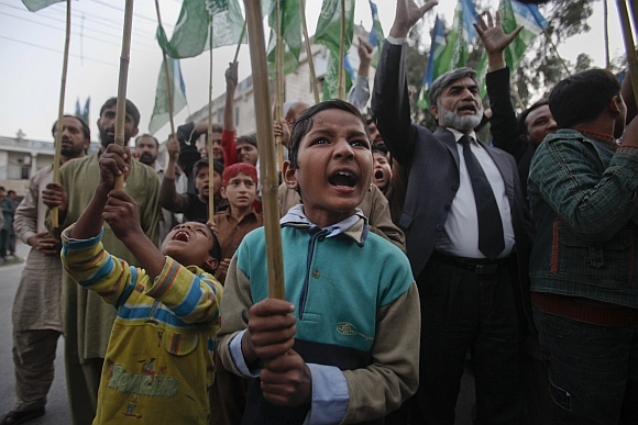 Young supporters of Jamaat-e-Islami, a religious and political party, yell anti-American slogans while protesting in Islamabad against a NATO cross-border attack