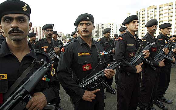 National Security Guard commandos stand during the opening of their new hub in Mumbai