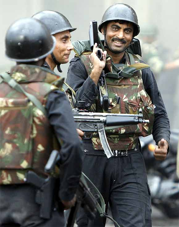 NSG commandos react after a successful operation to dislodge Islamist militants from Taj Mahal hotel in Mumbai November 29, 2008