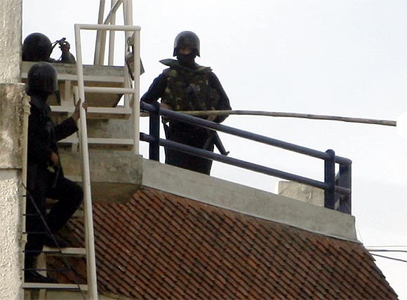 NSG commandos stand on the rooftop of Nariman House during the 26/11 rescue operation