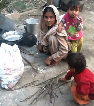 A woman cooks her family's evening meal