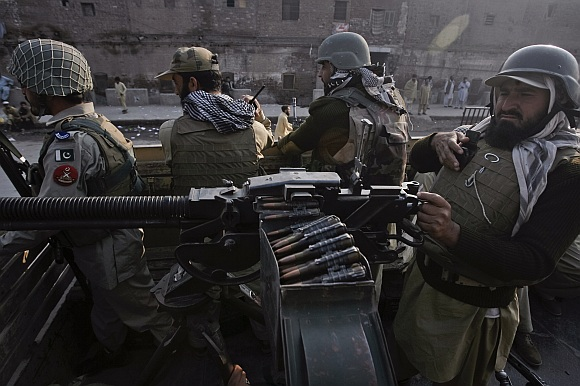 Paramilitary forces patrol the streets of Peshawar, in northwest Pakistan.