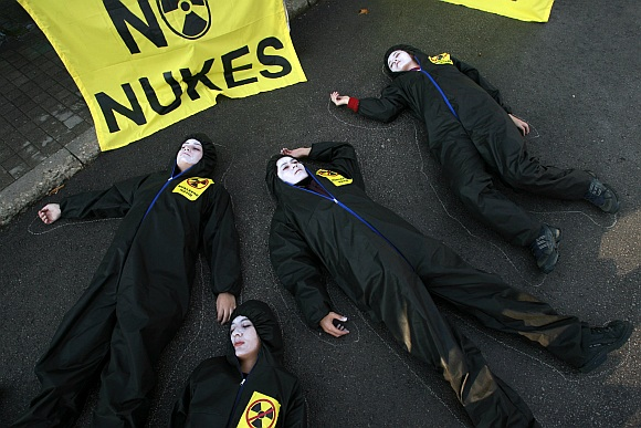 Greenpeace activists play dead in protest.