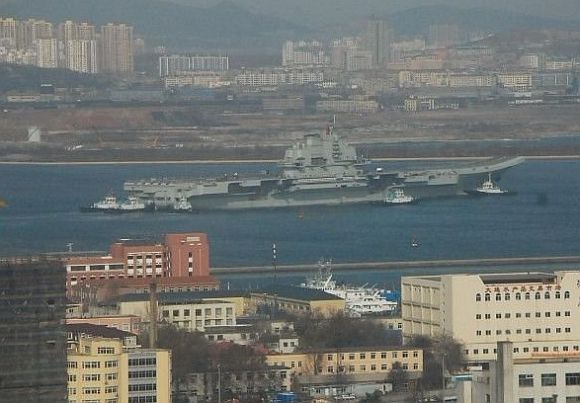 PHOTOS: China's aircraft carrier out for weapons check