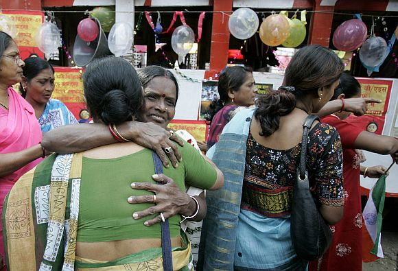 Sex workers participate in an AIDS awareness programme in Kolkata