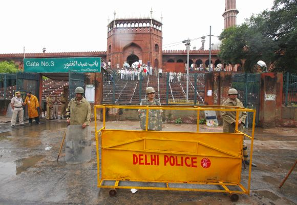 Police stand guard outside Jama Masjid in New Delhi after a shooting incident in September 2010