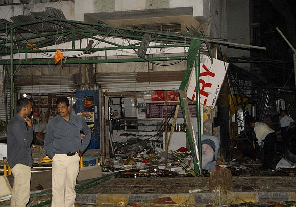 Police gather at the site of a bomb blast at the German Bakery restaurant in Pune on February 13, 2010