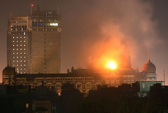 A burning Taj Mahal hotel during the 26/11 attacks in Mumbai