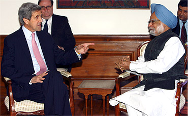A file photo of US Senator John Kerry with Prime Minister Manmohan Singh