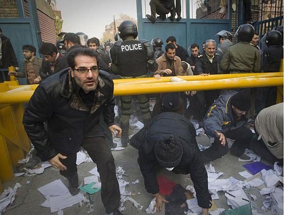 Protesters enter the gate of the British embassy in Tehran