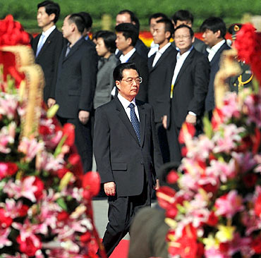 China's President Hu Jintao takes part in a National Day ceremony at Tiananmen Square in Beijing