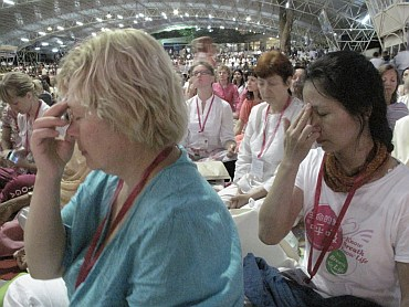 Foreign tourists indulge in meditation, satsang and Puja at an event in Bangalore