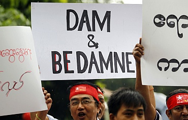 Kachin people from Myanmar hold placards during a protest in New Delhi