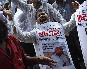File picture of supporters of Anna Hazare celebrating after the veteran activist ended his anti-corruption fast