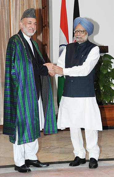 Prime Minister Dr Manmohan Singh greets President of Afghanistan Hamid Karzai in New Delhi