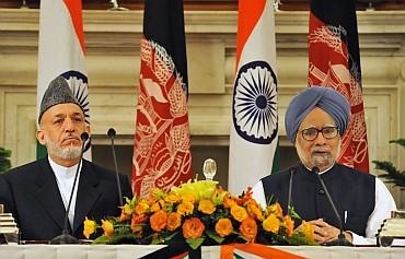 Prime Minister Manmohan Singh with Afghan President Hamid Karzai at a joint press conference