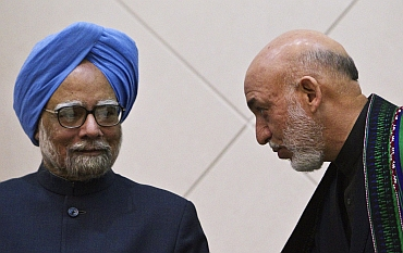 Dr Singh with Karzai