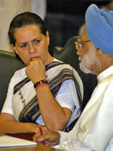 File picture of Congress chief Sonia Gandhi with PM Singh