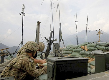 US soldiers from Task Force 'No Fear' 3rd Platoon, Alpha Company, 2-27 Infantry fire a 60mm mortar towards the Taliban position during an early morning firefight in Ghaziabad district at outpost Bari Ari in Kunar, Afghanistan in this picture taken on September 13, 2011