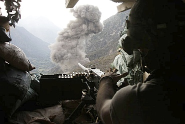 Smoke rises after a US military fighter jet dropped bombs at Taliban positions, as seen from a bunker of the US soldiers from Task Force