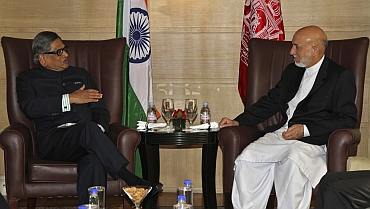 Foreign Minister SM Krishna speaks with Afghanistan's President Hamid Karzai during their meeting in New Delhi