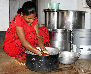 Malti prepares food at her new 'home'