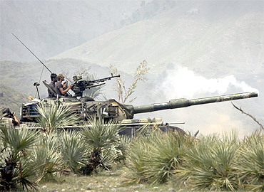 Soldiers fire at targets from their base camp along the Pakistan-Afghanistan border
