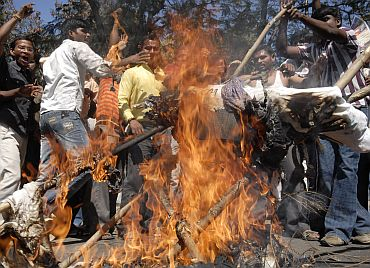 Pro-Telangana protesters shout slogans and burn an effigy of ruling Congress party-led government in Hyderabad