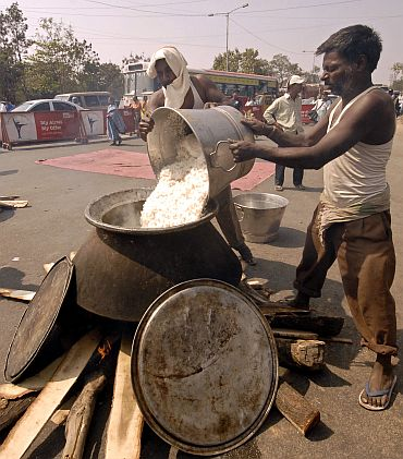 Telangana JAC members prepare food on the road during a protest in Hyderabad