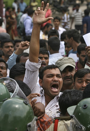 A demonstrator shouts anti-government slogans during a protest demanding statehood for Telangana