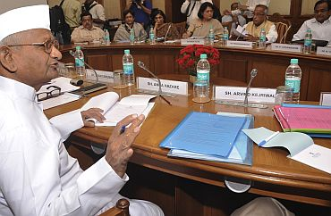 Team Anna members debate the provisions of the Lokpal Bill with government representatives in New Delhi