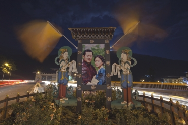 A portrait of Bhutan's King Jigme Khesar Namgyel Wangchuck and his bride Jetsun Pema is seen pictured in a roundabout in capital Thimphu