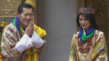 King Jigme Khesar Namgyel Wangchuck greets journalists after his marriage to Queen Jetsun Pema at the Punkaha Dzong in Bhutan's ancient capital Punakha