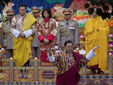 King Jigme Khesar Namgyel Wangchuck and his bride Jetsun Pema take part in a purification ceremony at the Punkaha Dzong during their wedding ceremony in Bhutan's ancient capital Punakha